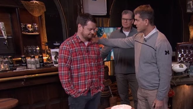 "Jim Harbaugh motivates Patrick O'Connor before  the ""Dan Patrick Show"" assistant puts his face into a pie."