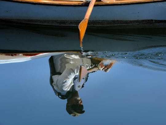 John Guider rows down the Tennessee River Thursday,