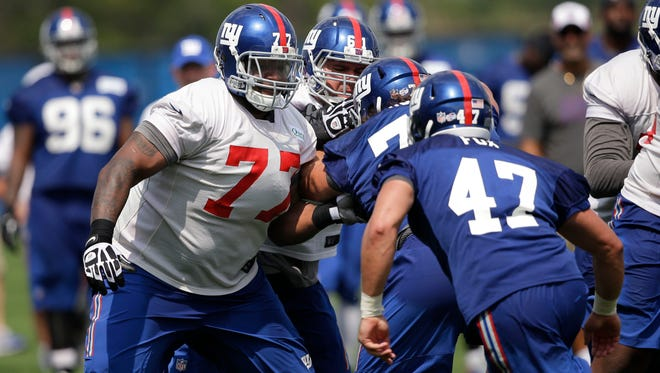 The Giants' John Jerry, left, practices during a NFL football camp in East Rutherford, N.J., on  Tuesday.