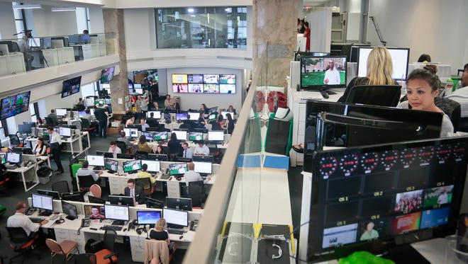 Staffers work in the Al Jazeera America newsroom after the network's first broadcast Aug. 20, 2013, in New York.
