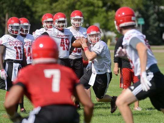 Austin Simmons throws a pass during USD football practice
