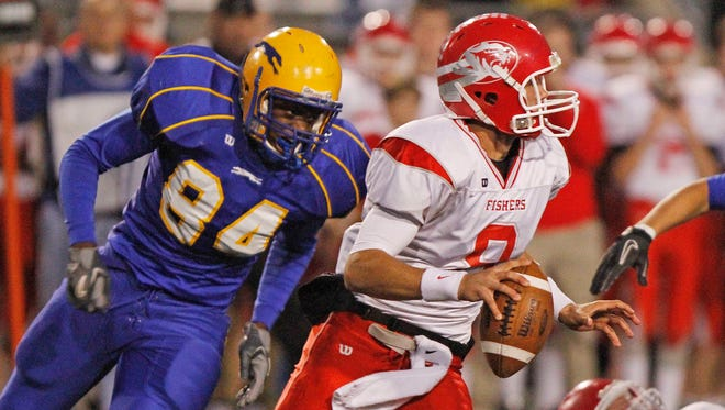 Carmel's DE Langston Newton chases down Fishers quarterback Koby Orris, Oct. 29, 2010.  Newton has transferred to Purdue from Kentucky.