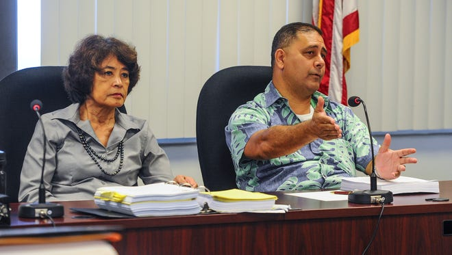 Anthony Camacho, left, Office of Public Accountability hearing officer speaks as he and OPA Public Auditor Doris Flores Brooks conduct a status hearing in Hagåtña on Thursday, Aug. 11. The hearing was held in regards to an appeal filed by Core Tech International Corporation against the Department of Public Works for the lease financing for the design, renovation, rehabilitation, construction, and maintenance of public schools.
