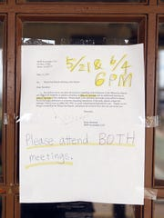 A notice to residents hangs on the clubhouse door at