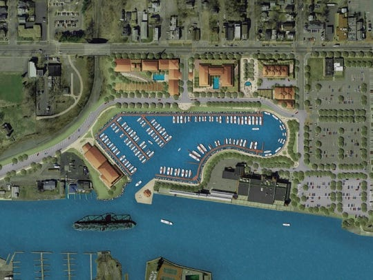 An overview of port development plans shows all phases of marina, housing and commercial construction.