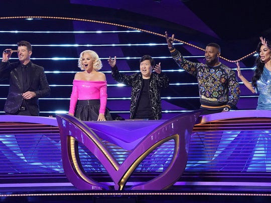 """Robin Thicke, Jenny McCarthy, Ken Jeong, guest panelist Jamie Foxx and Nicole Scherzinger of """"The Masked Singer,"""" which airs at 8 p.m. Wednesday on Fox."""
