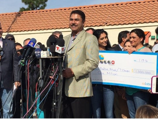 Balbir Atwal, owner of the Chino Hills 7-Eleven that sold a winning Powerball ticket, received a $1 million bonus check during a ceremony on Thursday, Jan. 14, 2016.