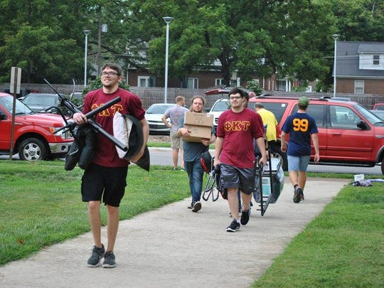Students move their belongings into University of Evansville dorms Saturday morning.