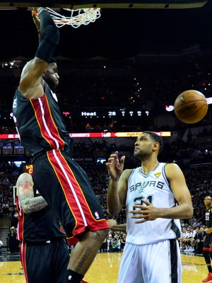 Heat forward LeBron James dunks right in front of Spurs forward Tim Duncan during Game 2 of the NBA Finals.