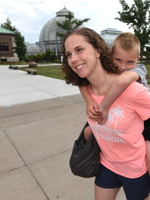 Erin George gives a piggy-back ride to her son Declan,
