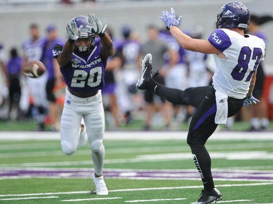 ACU safety A.J. Greathouse (20) almost blocks a punt during the Wildcats' final scrimmage of fall camp Saturday, Aug. 26, 2017 at Wildcat Stadium.