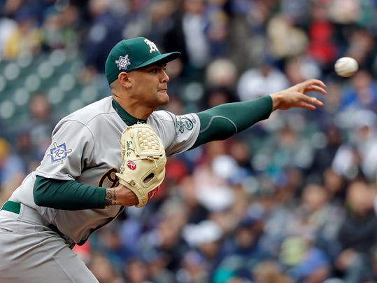 Oakland Athletics starting pitcher Sean Manaea throws against the Seattle Mariners in the first inning during a baseball game Sunday, April 15, 2018, in Seattle. (AP Photo/Elaine Thompson)