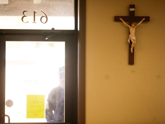 A client waits for St. Joseph Diner to open for and serve Thanksgiving meals in Lafayette Nov. 24, 2016. The program of Catholic led by Catholic Services of Acadiana offers essential services to preserve and enhance the lives of people experiencing poverty, hunger, and homelessness.