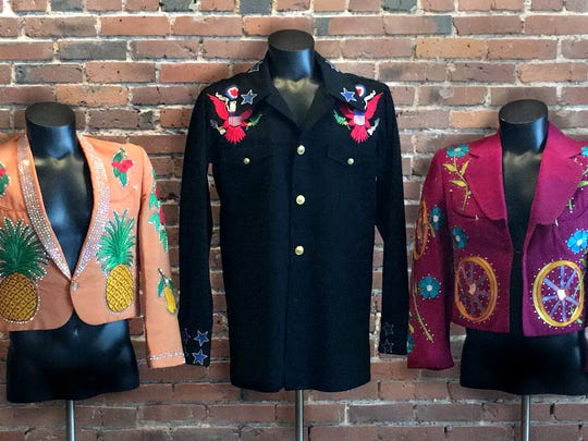 Among costumes exhibited at Nudie's Honky Tonk are: (left to right) Hank Snow, Johnny Cash and Little Jimmy Dickens.