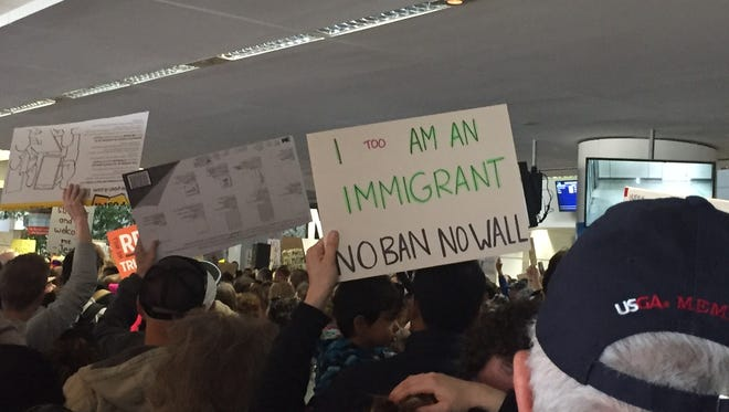 A protester at the San Francisco International Airport at a protest of President Trump's Executive Order on immigration.