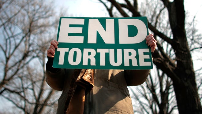 """Members and supporters of The Washington Region Religious Campaign Against Torture hold a rally to """"demand Congressional action to stop torture"""" on Capitol Hill in 2008."""