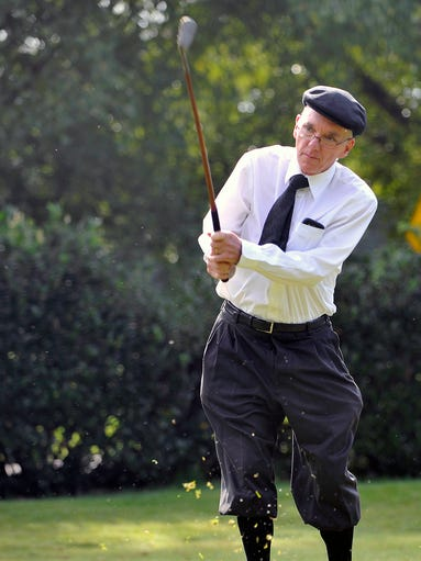 Dr. Stan Jennings, of Richmond, Va., plays in the US Hickory Open, a tournament in which players use old-time wooden shaft clubs and dress like players from a bygone era. The tourney was played at the Country Club of Asheville Friday. 8/15/14. Robert Bradley (rbradley@citizen-times.com)