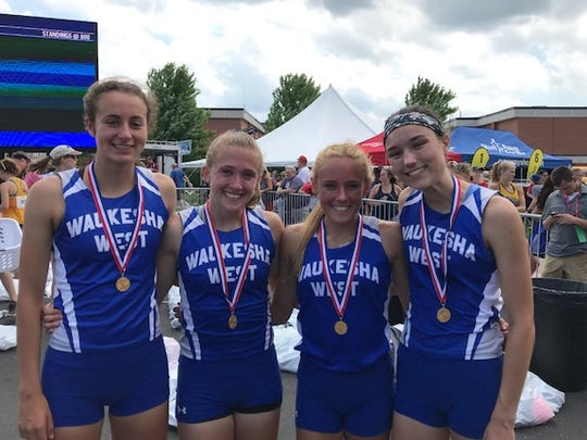 Members of the Waukesha West girls 3,200-meter relay team are (from left) Becca Langer, Maddie Frey, Brooke Lytle and Brooke Studnicki. Both Langer and Lytle have been on all three of West's consecutive champion teams.