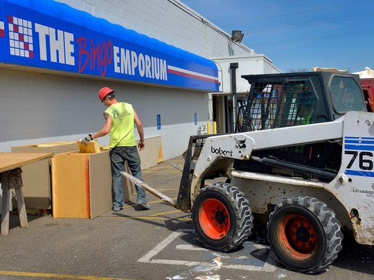 Workers from Alliance Building Corporation, Sauk Rapids, gut the former Bingo Emporium site Wednesday in St. Cloud. The business recently closed its doors, its leaders saying it won't reopen unless changes are made to the rules on the collection of taxes from gambling receipts.