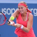 Petra Kvitova of Czech Republic returns to Flavia Pennetta of Italy on Day 10 of the U.S. Open.