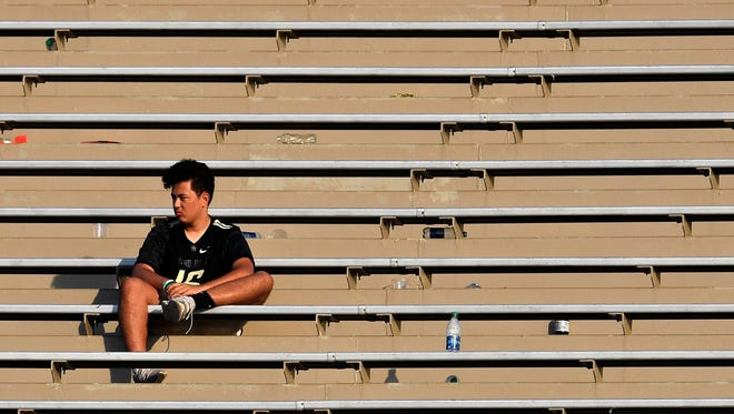A Vanderbilt fan sits alone in the stands after the Commodores lost to Alabama 59-0 at Vanderbilt Stadium Saturday, Sept. 23, 2017 in Nashville, Tenn.