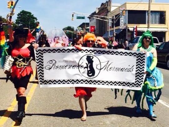 Dee McCallum (left to right), Tracy Coon and Jenn Mehm represent the Asbury Park Promenade of Mermaids in the Pride Parade in Asbury Park in June.