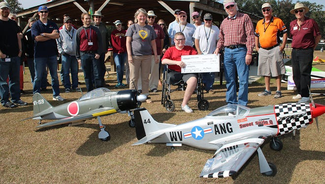 Seminole Radio Control Club presents a check to the Children's Miracle Network during an event a few years ago.