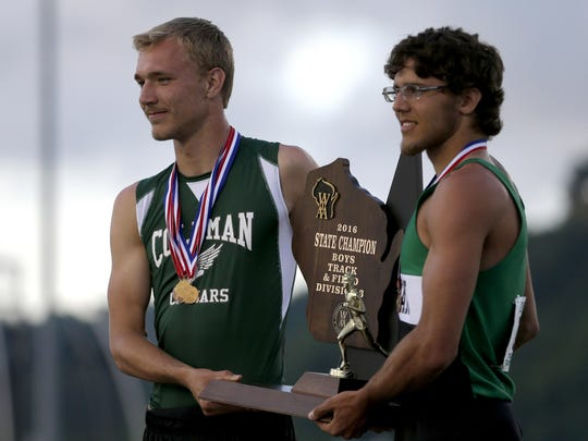 Josh Pillath, left, and Gunnar Patz, of Coleman, hold the trophy for their three-way tie to win a share of the WIAA Division 3 boys team state title on June 4 at Veterans Memorial Stadium in La Crosse.