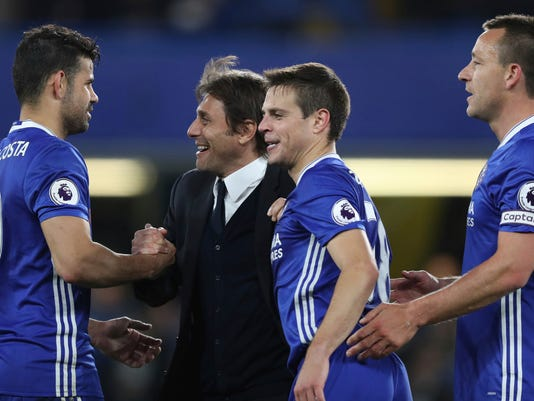 Chelsea's manager Antonio Conte congratulates Chelsea's Diego Costa, left, Cesar Azpilicueta, second right, and John Terry at the end of the English Premier League soccer match between Chelsea and Middlesbrough at Stamford Bridge stadium in London, Monday, May 8, 2017. Chelsea won the match 3-0. (AP Photo/Alastair Grant)