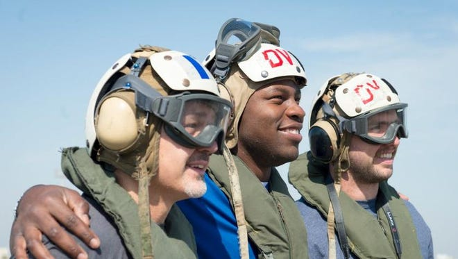 Coach Chuck Pagano, tight end Dwayne Allen and quarterback Andrew Luck aboard the USS Carl Vinson in March.