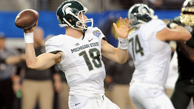 Former MSU offensive lineman Jack Conklin (74) is expected to be a first-round pick in the NFL Draft, but quarterback Connor Cook isn't sure when he'll hear his name called in the three-day event.