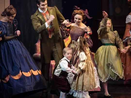 "Jack Barlow, center, 7, of Fort Thomas, dances in Cincinnati Ballet's ""The Nutcracker."""