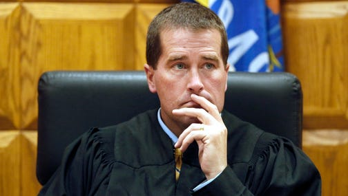 Judge Mark McGinnis listens during a 2013 preliminary hearing at the Outagamie County Justice Center in Appleton.
