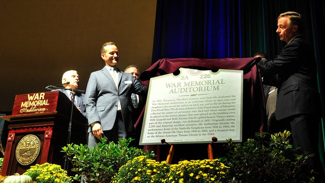 Brent Hyams, CEO of War Memorial Auditorium and Tennessee Performing Arts Center, helps Gov. Bill Haslam unveil a historical marker during the 90th birthday celebration for War Memorial Auditorium on Sept. 21, 2015.