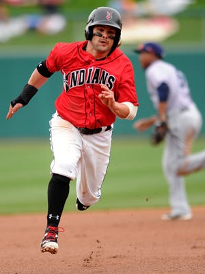 Indianapolis Indians base runner Jaff Decker runs towards third base to eventually score on a Andrew Lambo double against the Columbus Clippers at Victory Field, Sunday, April 13, 2014, in Indianapolis.