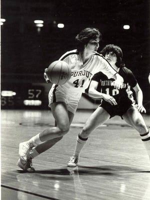 Purdue guard Carol Emanuel drives against a Northwestern defender.