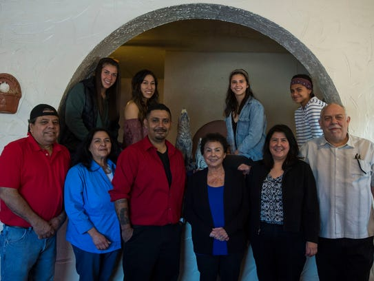 Dorothy Godinez, front-center, who helped start and build the restaurant with her late husband Jess, poses with some of her family that have all worked at the restaurant in some fashion, as seen on Friday, April 27, 2018 at El Burrito Family Mexican Restaurant in Fort Collins, Colo.