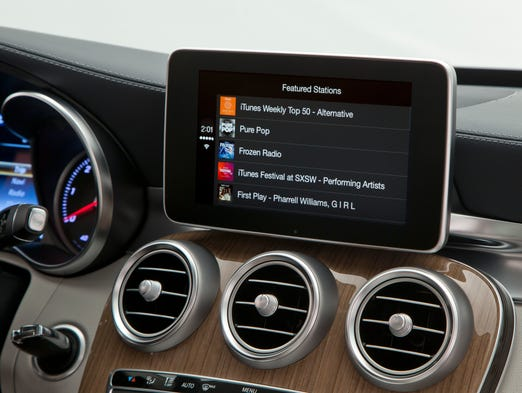 Autos carplay brings iphones to vehicles for Mercedes benz music system