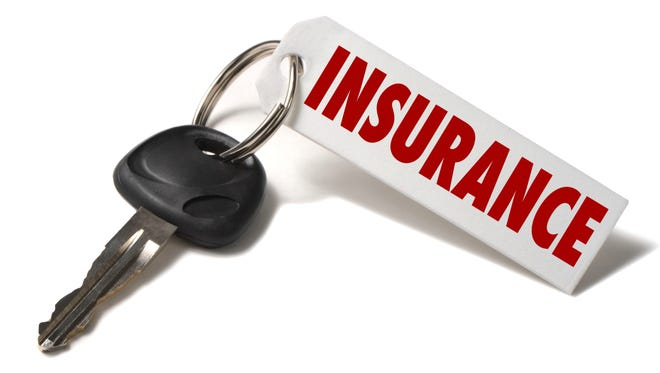 Car Key with Insurance Tag on White