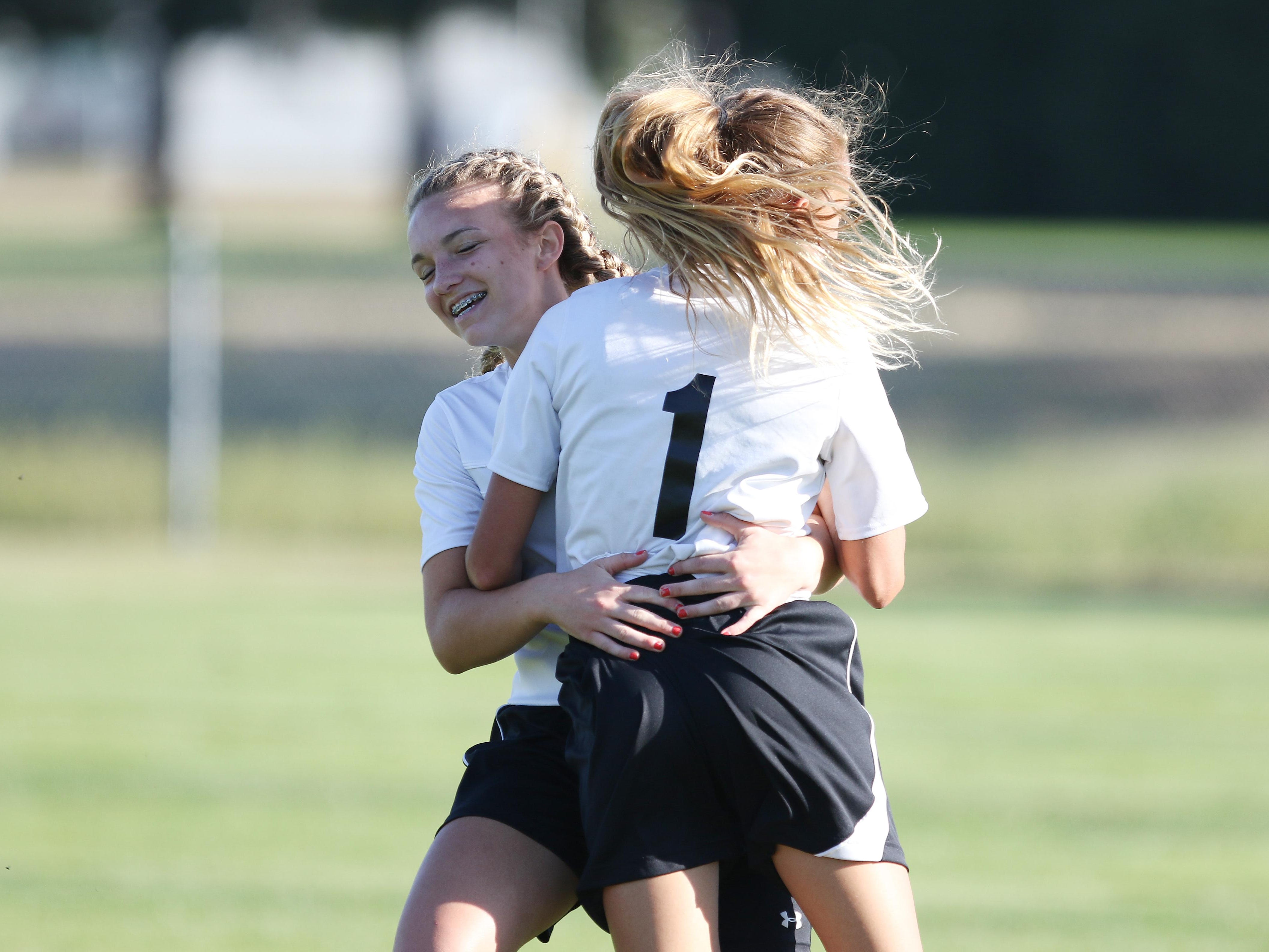 Cascade's Emma Woods and Brooklyn Petterson (No. 1) embrace as Cascade defeats Stayton 2-1 in an Oregon West Conference game Thursday in Turner.