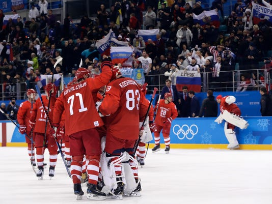 Russian athletes celebrate after the preliminary round of the men's hockey game against the United States at the 2018 Winter Olympics in Gangneung, South Korea, Saturday, Feb. 17, 2018. Olympic Athletes from Russia won 4-0. (AP Photo/Matt Slocum)