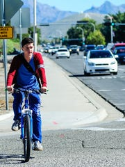 New Mexico State University student Daniel Wong, 18, bikes down East University Avenue while heading to microbiology class on Monday.