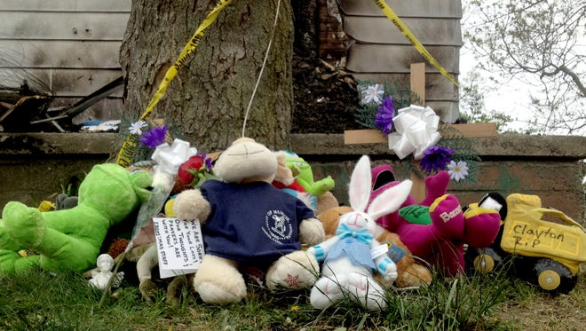 An informal memorial set up after Thursday's fire on Daly Avenue had grown by midday Friday.