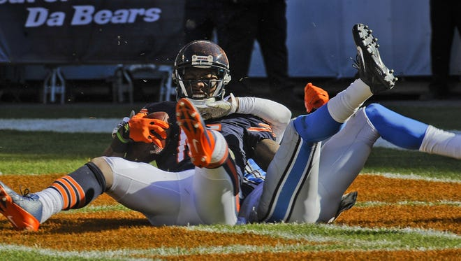Chicago Bears wide receiver Brandon Marshall (15) catches a touchdown against the Detroit Lions cornerback Darius Slay (30) in the 1st quarter at Soldier Field.
