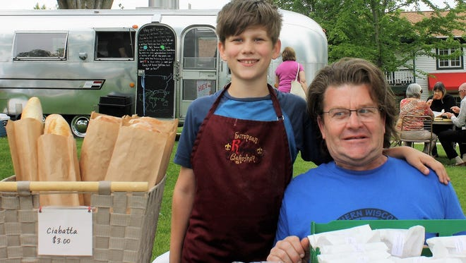 Brian Taylor and son, Rhyes, of Renard, are just one of the many vendors at the Indoor Fall Market at Town Square.