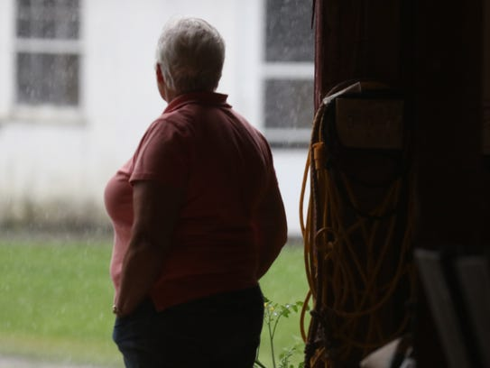 Watching a downpour, dairy farmer Kerry Adams said