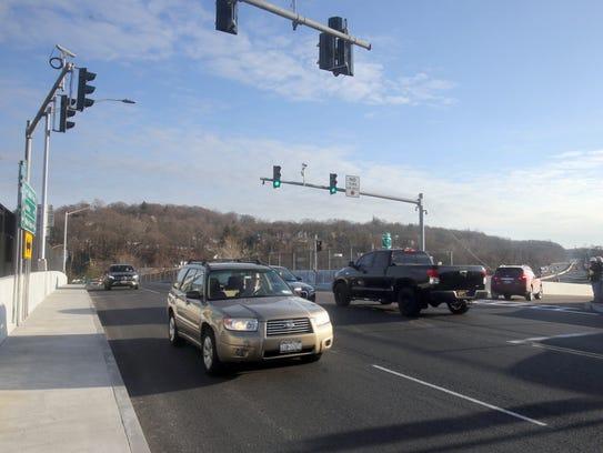 Cars drive on the rebuilt Ashford Avenue bridge Feb.