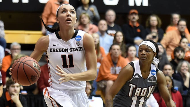 Oregon State's Gabby Hanson drives past Troy's ArJae' Saunders in the first half. Hanson had nine points and four assists and was a catalyst for the Beavers' defense.