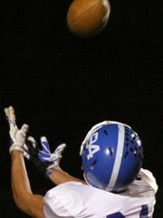 Assumption's John Gudelis caught two touchdown passes including this 39-yarder in the first quarter.
