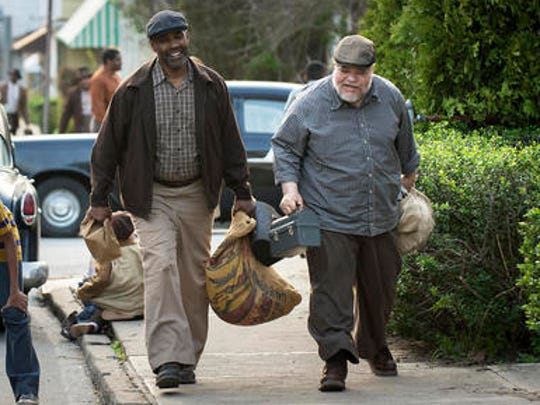 "Denzel Washington (center) and Stephen McKinley Henderson (right) appear in ""Fences."""